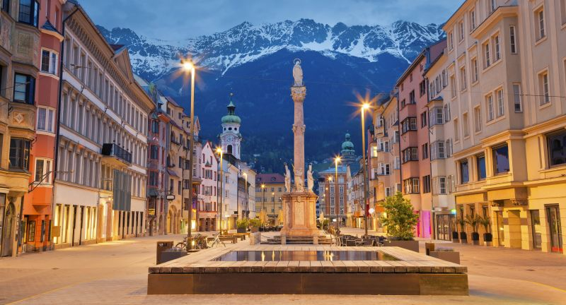 innsbruck, austria, tirol, european alps, city, urban scene, town, springtime, travel, dusk, architecture, house, europe, cityscape, urban skyline, travel destinations, outdoors, national landmark, mountain range, twilight, church, overcast, mountain peak, downtown district, street, town square
